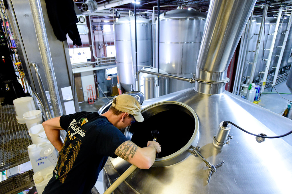 . Elliott Schmitz, Brew House Operator, works at the Oskar Blues brewery in Longmont, Colorado on Oct. 3, 2017. The amount of water needed to make a barrel of beer has been reduced though a process of reclaiming, cleaning and reusing for portions of the brewing process. (Photo by Matthew Jonas/Times-Call)