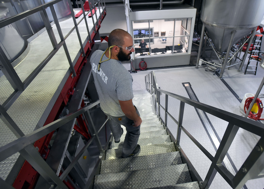. Head brewer, Fred Rizzo, walks down to the Avery Brewing main brewing floor and operations station.  Avery Brewing main brewing floor and operations station. Beer Brewing activity at Avery Brewery in Boulder. Cliff Grassmick  Staff Photographer October 6, 2017