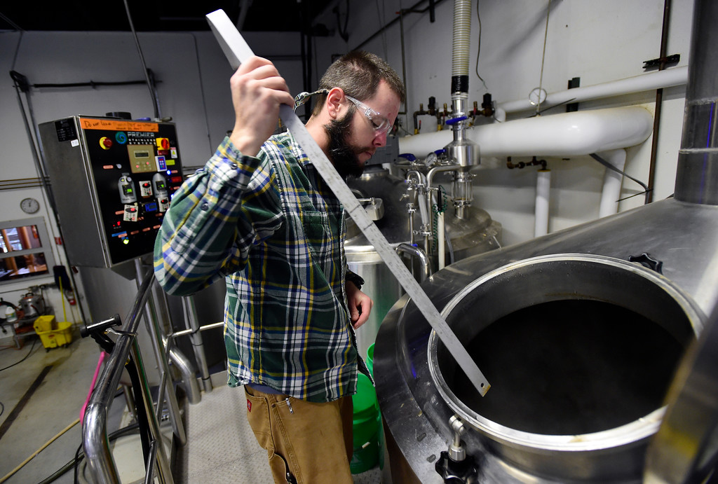 . Brewer Andy Sanchez checks the levels of IPA runoff at Upslope Brewing on Monday in Boulder. For more photos of activity at Upslope Brewing go to dailycamera.com Jeremy Papasso/ Staff Photographer/ Oct. 9, 2017