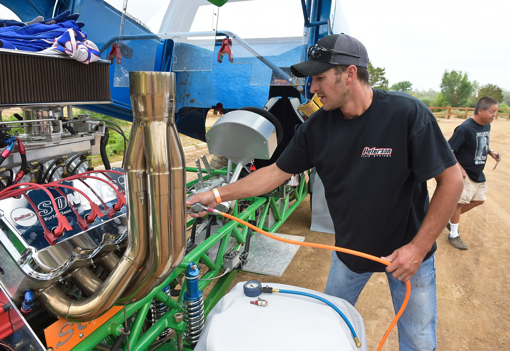 . Tyler Greene, of Fort Morgan, prepares his truck for the truck and tractor pull at the Boulder County Fair Sunday evening. To view more photos visit timescall.com. Lewis Geyer/Staff Photographer August 06, 2017
