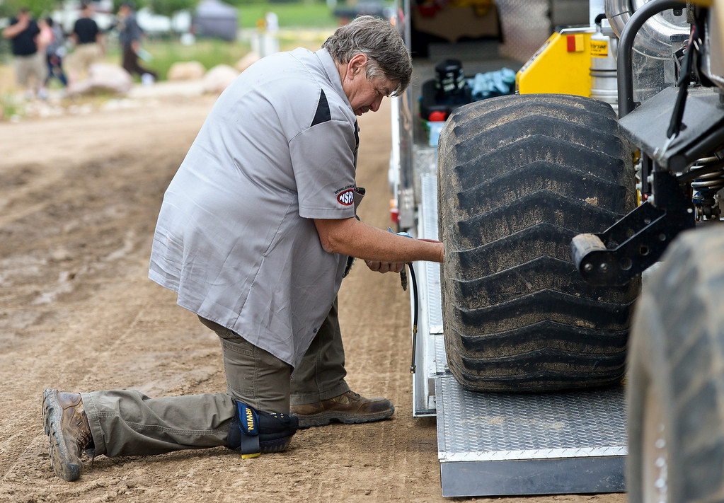 . Ron Greene checks his tire pressure before competing in the truck and tractor pull at the Boulder County Fair Sunday evening. To view more photos visit timescall.com. Lewis Geyer/Staff Photographer August 06, 2017