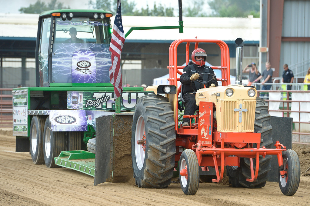 . Charles Ruyle, 67, of Wiggins, pulls the sled with his 1958 Case tractor the truck and tractor pull at the Boulder County Fair Sunday evening. Ryle said he has been involved with tractor pulling for 45 years. To view more photos visit timescall.com. Lewis Geyer/Staff Photographer August 06, 2017