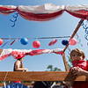 "Cody Smith, 6,  waits with Samantha Brady on the ""Sit Means Sit"" dog training float prior to the Boulder County Fair Parade in Longmont on Saturday.<br /> More photos:  <a href=""http://www.dailycamera.com"">http://www.dailycamera.com</a><br /> (Autumn Parry/Staff Photographer)<br /> July 30, 2016"