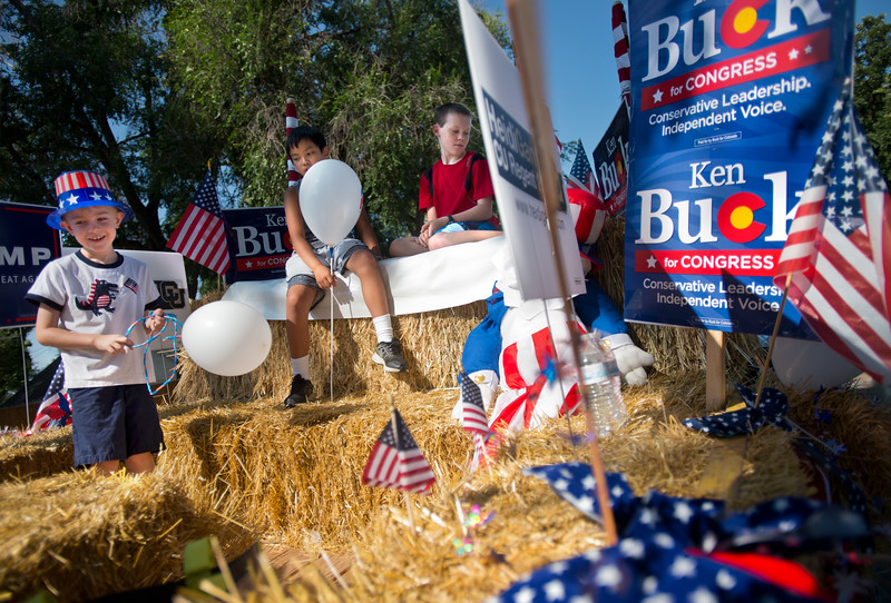 "From left to right, Finn O'Dell, 5, Timmy Knipscheer, 10, and Andrew Brown, 11, wait on the Boulder County Republican float prior to the Boulder County Fair Parade at Roosevelt Park in Longmont on Saturday. <br /> More photos:  <a href=""http://www.dailycamera.com"">http://www.dailycamera.com</a><br /> (Autumn Parry/Staff Photographer)<br /> July 30, 2016"