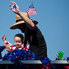 "People riding on the Deluxe Barbers float wave to the crowd during the Boulder County Fair Parade in Longmont on Saturday.<br /> More photos:  <a href=""http://www.dailycamera.com"">http://www.dailycamera.com</a><br /> (Autumn Parry/Staff Photographer)<br /> July 30, 2016"