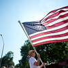 "Dan Gould, with the Boulder County Democratic Party float, carries an American flag during the Boulder County Fair Parade in Longmont on Saturday.<br /> More photos:  <a href=""http://www.dailycamera.com"">http://www.dailycamera.com</a><br /> (Autumn Parry/Staff Photographer)<br /> July 30, 2016"
