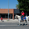 "A man greets the crowd as he rides on a horse during the Boulder County Fair Parade in Longmont on Saturday. <br /> More photos:  <a href=""http://www.dailycamera.com"">http://www.dailycamera.com</a><br /> (Autumn Parry/Staff Photographer)<br /> July 30, 2016"