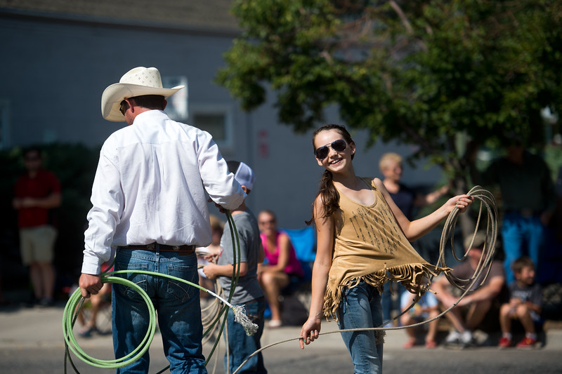 "Members with Heel-O-Matic Training Systems tried to lasso a fake bull during the Boulder County Fair Parade in Longmont on Saturday. <br /> More photos:  <a href=""http://www.dailycamera.com"">http://www.dailycamera.com</a><br /> (Autumn Parry/Staff Photographer)<br /> July 30, 2016"