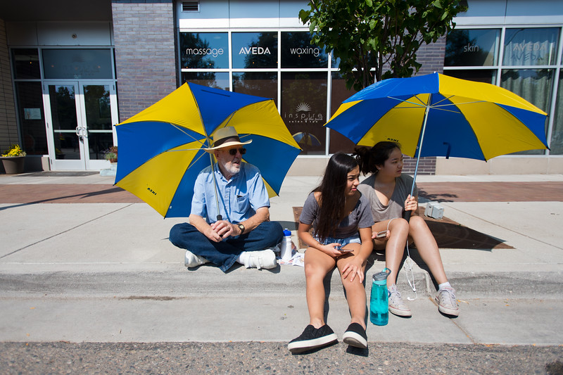 "From left to right, Roger Pratt, Sofia Messina and Grace Kilen, shade themselves from the sun as they watch the Boulder County Fair Parade in Longmont on Saturday. <br /> More photos:  <a href=""http://www.dailycamera.com"">http://www.dailycamera.com</a><br /> (Autumn Parry/Staff Photographer)<br /> July 30, 2016"
