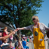 "Veronica Pease, with the Boulder Optimist Club, hands out bead necklaces during the Boulder County Fair Parade in Longmont on Saturday. <br /> More photos:  <a href=""http://www.dailycamera.com"">http://www.dailycamera.com</a><br /> (Autumn Parry/Staff Photographer)<br /> July 30, 2016"