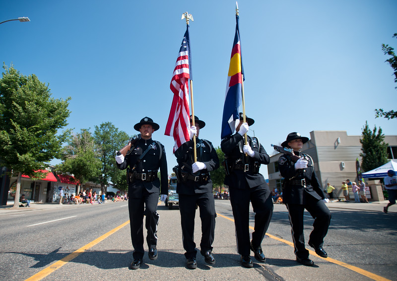"Officers from the Boulder County Sheriff's Office march during the Boulder County Fair Parade in Longmont on Saturday. <br /> More photos:  <a href=""http://www.dailycamera.com"">http://www.dailycamera.com</a><br /> (Autumn Parry/Staff Photographer)<br /> July 30, 2016"
