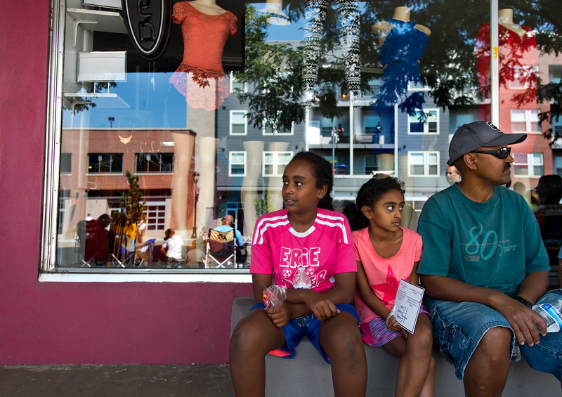 "From left to right, Waltana Haile, 12, her sister Mela Haile, 8, and their dad, Haile Negash, watch the Boulder County Fair Parade in Longmont on Saturday. <br /> More photos:  <a href=""http://www.dailycamera.com"">http://www.dailycamera.com</a><br /> (Autumn Parry/Staff Photographer)<br /> July 30, 2016"