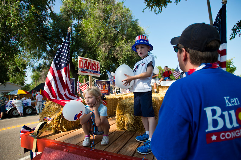 "Luke O'Dell (right) talks with his kids Finn O'Dell, 5, and Bridget O'Dell, 4, as they wait on the Boulder County Republican float prior to the Boulder County Fair Parade at Roosevelt Park in Longmont on Saturday. <br /> More photos:  <a href=""http://www.dailycamera.com"">http://www.dailycamera.com</a><br /> (Autumn Parry/Staff Photographer)<br /> July 30, 2016"