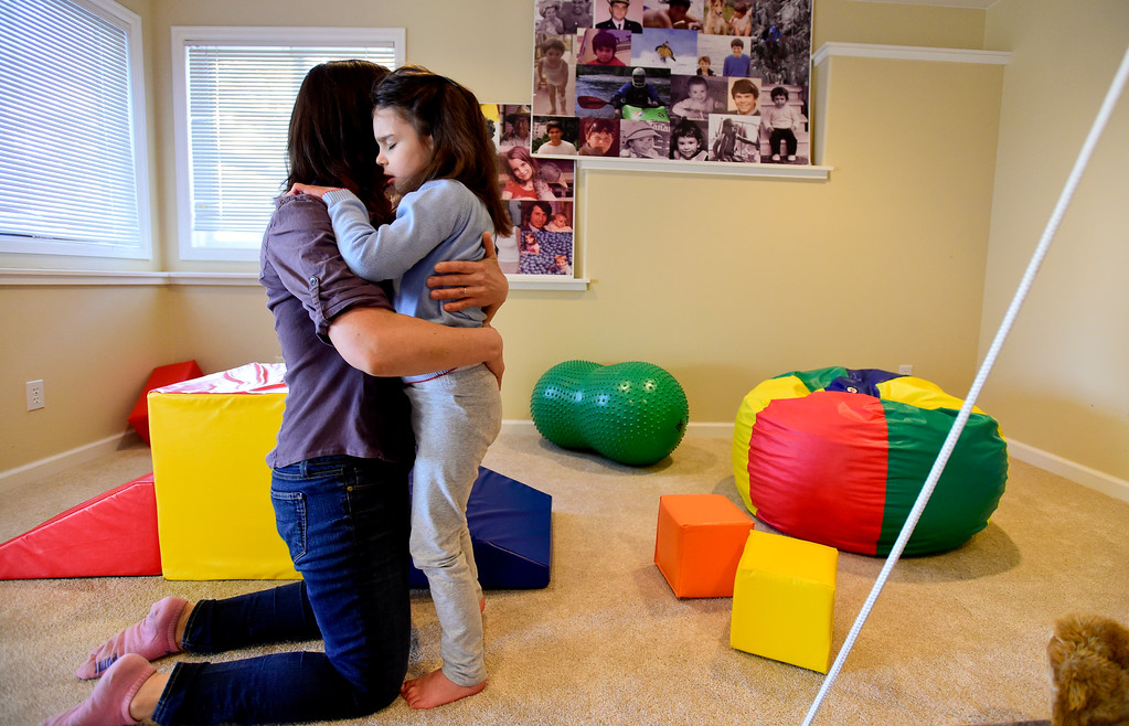 . Julia Vitarello, hugs daughter Mila Makovec, 6, while playing the basement of their home in Boulder County on Friday. Mila Makovec has been diagnosed with Batten disease, a terminal neurodegenerative disorder with no known cure. More photos: TimesCall.com. Matthew Jonas/Staff Photographer Jan. 13,  2017
