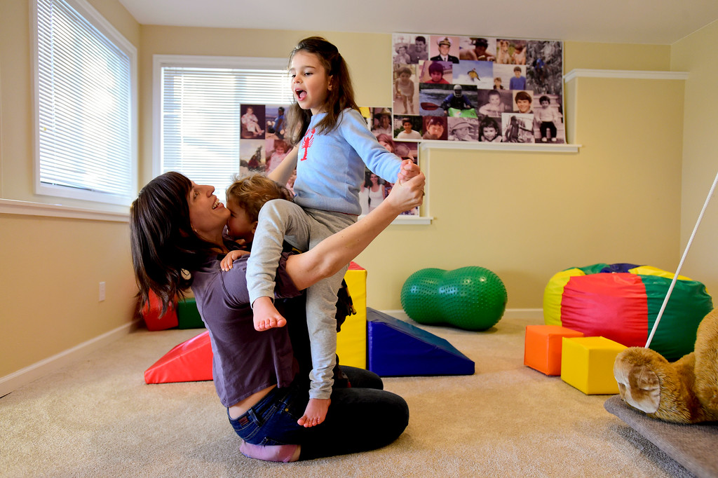 . Julia Vitarello, left, plays with daughter Mila Makovec, 6, and her brother Azlan Makovec, 2, at their home in Boulder County on Friday. Mila Makovec has been diagnosed with Batten disease, a rare terminal neurodegenerative disorder with no known cure. More photos: TimesCall.com. Matthew Jonas/Staff Photographer Jan. 13,  2017