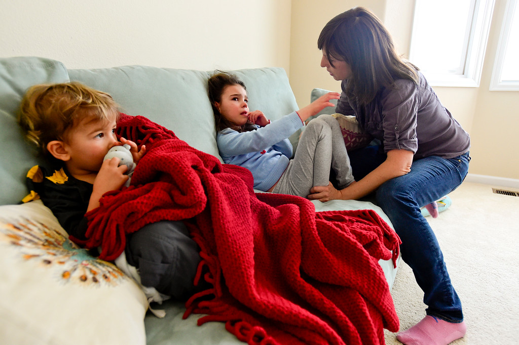 . Azlan Makovec, 2, left, watches TV as Julia Vitarello, right, talks with daughter Mila Makovec, 6, at their home in Boulder County on Friday. Mila Makovec has been diagnosed with Batten disease, a terminal neurodegenerative disorder with no known cure. More photos: TimesCall.com. Matthew Jonas/Staff Photographer Jan. 13,  2017
