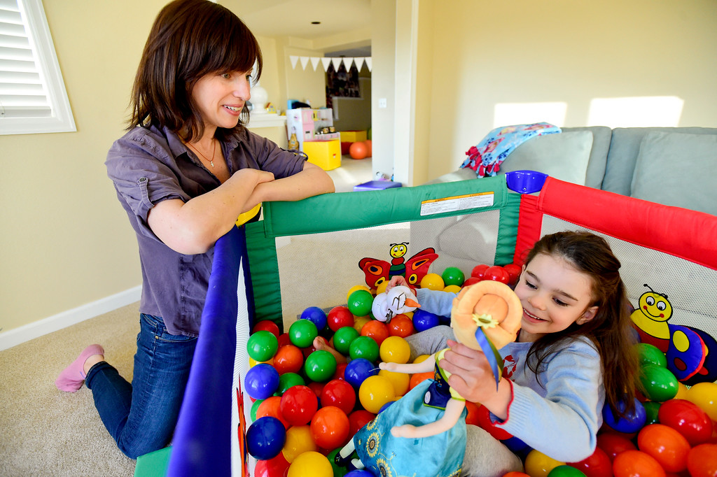 . Julia Vitarello, left, plays with daughter Mila Makovec, 6, right, at their home in Boulder County on Friday. Mila Makovec has been diagnosed with Batten disease, a terminal neurodegenerative disorder with no known cure. More photos: TimesCall.com. Matthew Jonas/Staff Photographer Jan. 13,  2017
