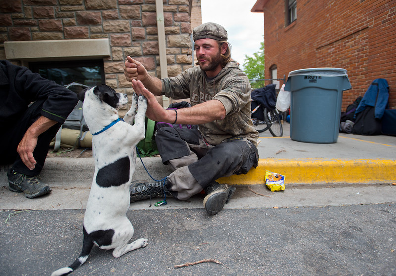"Barak Gills, a homeless man, trades treats for tricks with his dog Jack while waiting for lunch outside of the Carriage House in Boulder on Friday. <br /> More photos:  <a href=""http://www.dailycamera.com"">http://www.dailycamera.com</a><br /> (Autumn Parry/Staff Photographer)<br /> May 27, 2016"
