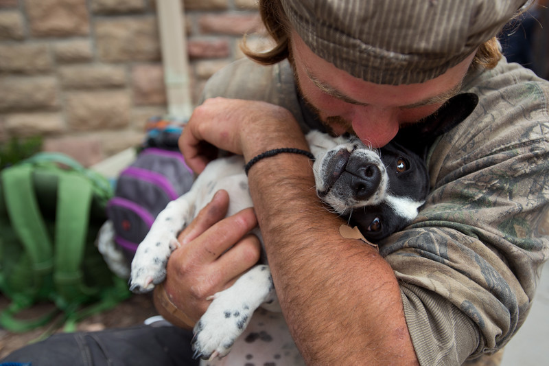 "Barak Gills, a homeless man, hugs his dog Jack while waiting for lunch outside of the Carriage House in Boulder on Friday. <br /> More photos:  <a href=""http://www.dailycamera.com"">http://www.dailycamera.com</a><br /> (Autumn Parry/Staff Photographer)<br /> May 27, 2016"