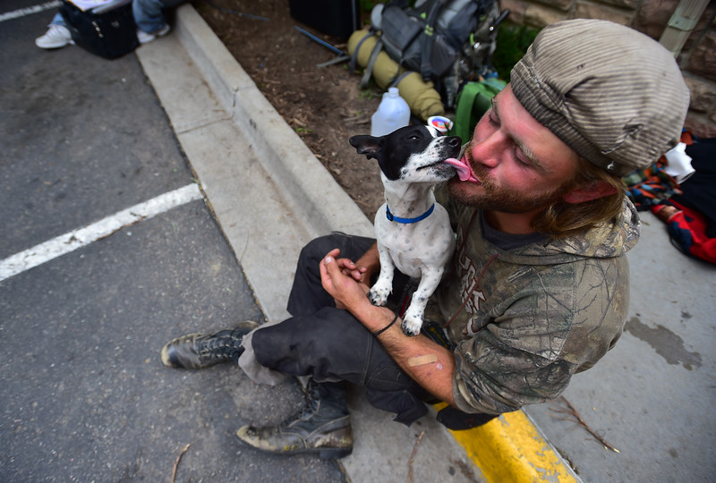 "Barak Gills, a homeless man, kisses his dog Jack while waiting for lunch outside of the Carriage House in Boulder on Friday. <br /> More photos:  <a href=""http://www.dailycamera.com"">http://www.dailycamera.com</a><br /> (Autumn Parry/Staff Photographer)<br /> May 27, 2016"