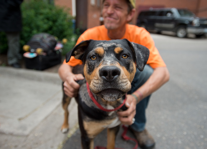 """A homeless man who asked to be referred to as J. sits with his dog Tom Tom outside of the Carriage House in Boulder on Friday. <br /> More photos:  <a href=""""http://www.dailycamera.com"""">http://www.dailycamera.com</a><br /> (Autumn Parry/Staff Photographer)<br /> May 27, 2016"""