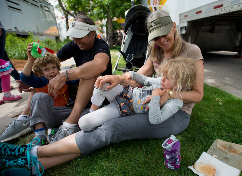 "Liz Vanek sits with her granddaughter Alana Vanek, 4, her husband Steven Vanek and their grandson Chase Vanek, 6, as they take a break for lunch at the Boulder Creek Festival in Central Park on Sunday. <br /> More photos:  <a href=""http://www.dailycamera.com"">http://www.dailycamera.com</a><br /> (Autumn Parry/Staff Photographer)<br /> May 29, 2016"