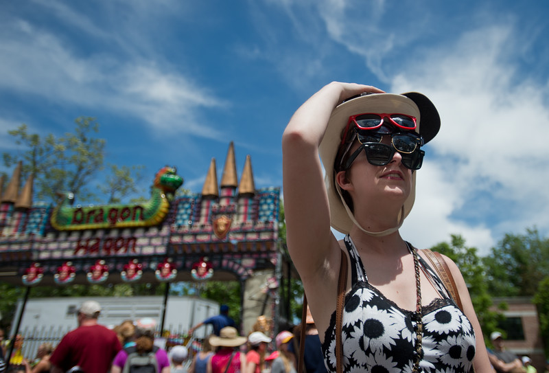 "Anna Slover, who referred to herself as a ""pack mule,""  holds onto her friends sunglasses and hats as they ride ""Spin Out"" during the Boulder Creek Festival in Central Park on Sunday.<br /> More photos:  <a href=""http://www.dailycamera.com"">http://www.dailycamera.com</a><br /> (Autumn Parry/Staff Photographer)<br /> May 29, 2016"
