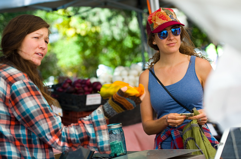 "Cory Hibbard (right) purchases peppers from Red Wagon Farm at the Farmers' Market in Boulder on Saturday. Boulder is looking into having a year-round public market on 13th Street between Arapahoe Ave. and Canyon Blvd. <br /> More photos:  <a href=""http://www.dailycamera.com"">http://www.dailycamera.com</a><br /> (Autumn Parry/Staff Photographer)<br /> September 24, 2016"