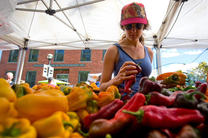"Cory Hibbard shops for peppers from Red Wagon Farm at the Farmers' Market in Boulder on Saturday. Boulder is looking into having a year-round public market on 13th Street between Arapahoe Ave. and Canyon Blvd. <br /> More photos:  <a href=""http://www.dailycamera.com"">http://www.dailycamera.com</a><br /> (Autumn Parry/Staff Photographer)<br /> September 24, 2016"