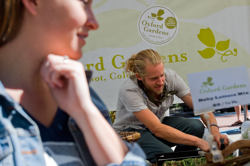 "Oxford Garden's Farm Manager Brady Anderson accepts pay for a customer's purchase during the Farmers' Market in Boulder on Saturday. Boulder is looking into having a year-round public market on 13th Street between Arapahoe Ave. and Canyon Blvd. <br /> More photos:  <a href=""http://www.dailycamera.com"">http://www.dailycamera.com</a><br /> (Autumn Parry/Staff Photographer)<br /> September 24, 2016"