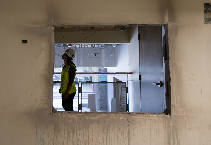 """Sabina Fedrowitz, a project engineer, tours Boulder High School, which is currently under construction as part of the renovations from 2014's bond issue, on Thursday.<br /> More photos:  <a href=""""http://www.dailycamera.com"""">http://www.dailycamera.com</a><br /> (Autumn Parry/Staff Photographer)<br /> June 30, 2016"""
