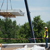 "Roof metal flashing is lifted to the roof to cap the perimeter during construction at Boulder High School on Thursday. Renovations at Boulder High are part of the first phase of school construction projects from 2014's $576 million bond issue. Boulder Valley has 22 projects under construction this summer.<br /> More photos:  <a href=""http://www.dailycamera.com"">http://www.dailycamera.com</a><br /> (Autumn Parry/Staff Photographer)<br /> June 30, 2016"