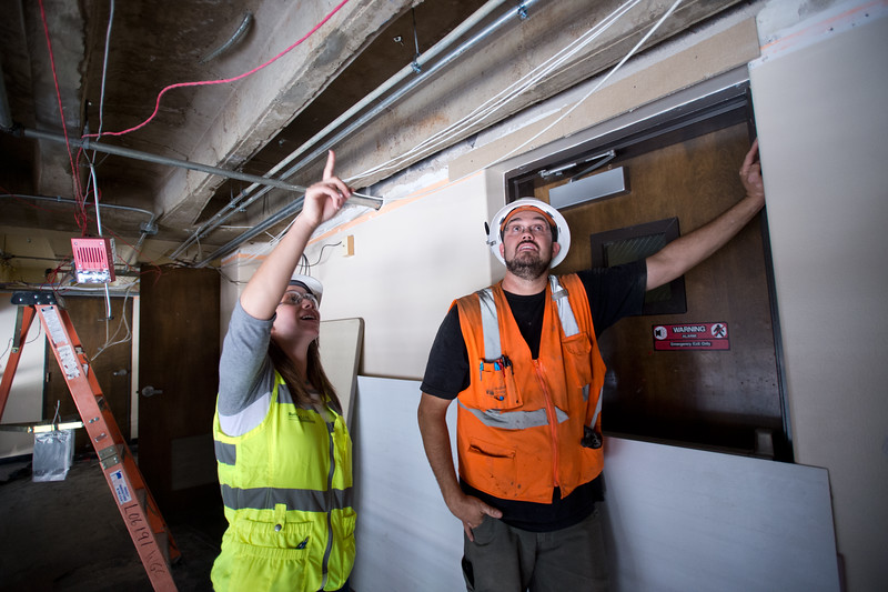 """Sabina Fedrowitz, a project engineer, and Mark Odorisio, a job site foreman, discuss where exits signs will be placed, at Boulder High School on Thursday. Renovations at Boulder High are part of the first phase of school construction projects from 2014's $576 million bond issue. <br /> More photos:  <a href=""""http://www.dailycamera.com"""">http://www.dailycamera.com</a><br /> (Autumn Parry/Staff Photographer)<br /> June 30, 2016"""