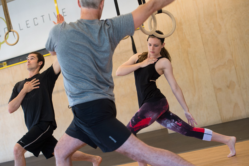 "From left to right, Kevin Eno, Kevin Bundy and his daughter Allison Bundy stretch in a warm-up exercise during a class at Boulder Movement Collective on Thursday. The classes are programed to have aspects of hand-balancing, mobility, gymnastic strength work and a movement focused skill aspect, with some coordination, locomotion patterns and dance foot work.<br /> More photos:  <a href=""http://www.dailycamera.com"">http://www.dailycamera.com</a><br /> (Autumn Parry/Staff Photographer)<br /> July 7, 2016"