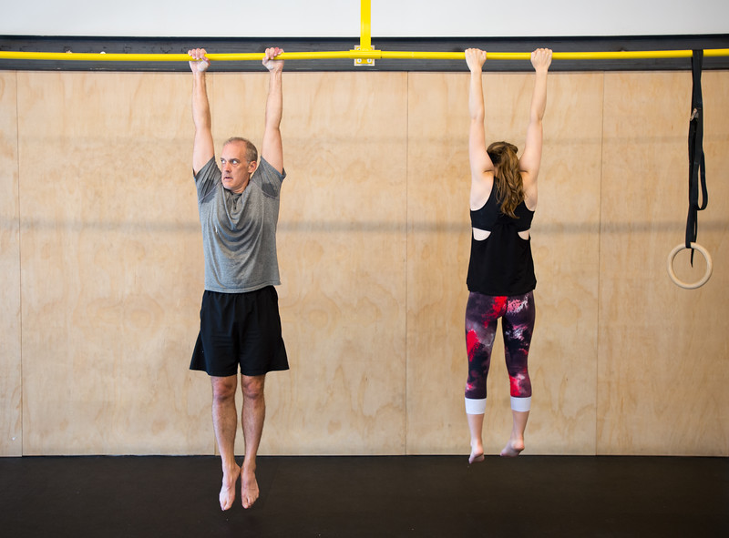"Kevin Bundy and his daughter Allison Bundy hang from the pole in a brief exercise during a class at Boulder Movement Collective on Thursday. The classes are programed to have aspects of hand-balancing, mobility, gymnastic strength work and a movement focused skill aspect, with some coordination, locomotion patterns and dance foot work.<br /> More photos:  <a href=""http://www.dailycamera.com"">http://www.dailycamera.com</a><br /> (Autumn Parry/Staff Photographer)<br /> July 7, 2016"