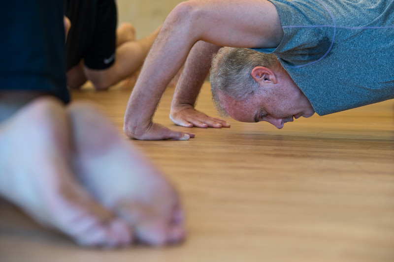 "Kevin Bundy stretches in a warm-up exercise during a class at Boulder Movement Collective on Thursday. The classes are programed to have aspects of hand-balancing, mobility, gymnastic strength work and a movement focused skill aspect, with some coordination, locomotion patterns and dance foot work.<br /> More photos:  <a href=""http://www.dailycamera.com"">http://www.dailycamera.com</a><br /> (Autumn Parry/Staff Photographer)<br /> July 7, 2016"