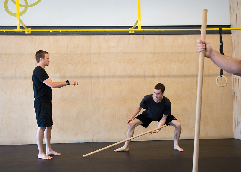 "Matt Baran-Mickle and Kevin Eno participate in the stick drop game as part of a warm-up to test reaction skills during a class at Boulder Movement Collective on Thursday. The classes are programed to have aspects of hand-balancing, mobility, gymnastic strength work and a movement focused skill aspect, with some coordination, locomotion patterns and dance foot work.<br /> More photos:  <a href=""http://www.dailycamera.com"">http://www.dailycamera.com</a><br /> (Autumn Parry/Staff Photographer)<br /> July 7, 2016"