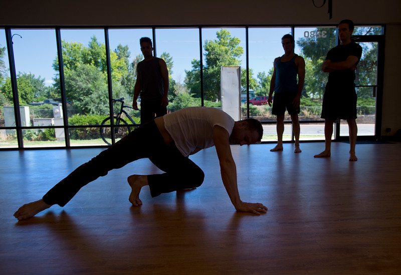 "Matt Bernstein, instructor and co-owner of Boulder Movement Collective, demonstrates the QDR position during a class at Boulder Movement Collective on Thursday. The classes are programed to have aspects of hand-balancing, mobility, gymnastic strength work and a movement focused skill aspect, with some coordination, locomotion patterns and dance foot work.<br /> More photos:  <a href=""http://www.dailycamera.com"">http://www.dailycamera.com</a><br /> (Autumn Parry/Staff Photographer)<br /> July 7, 2016"