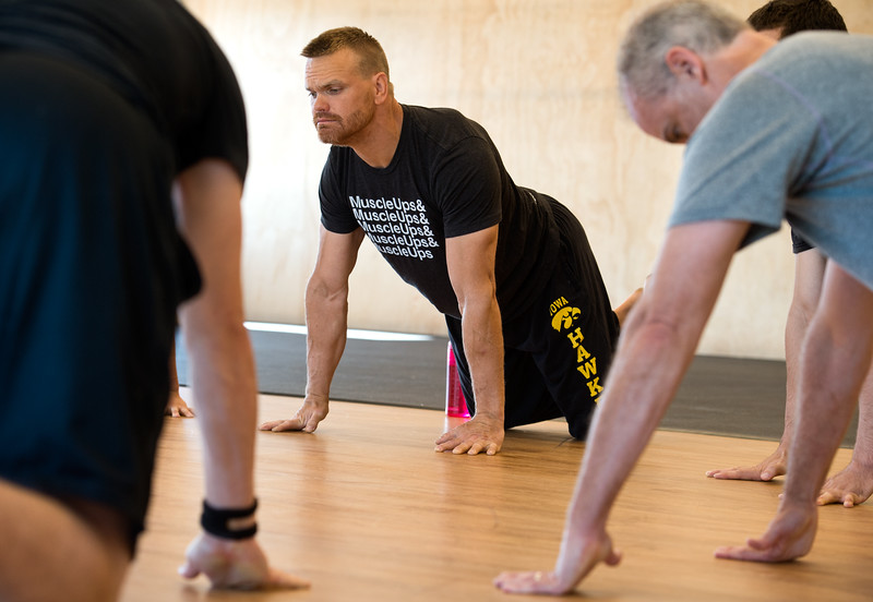 "Damon Arthur stretches for an exercise during a class at Boulder Movement Collective on Thursday. The classes are programed to have aspects of hand-balancing, mobility, gymnastic strength work and a movement focused skill aspect, with some coordination, locomotion patterns and dance foot work.<br /> More photos:  <a href=""http://www.dailycamera.com"">http://www.dailycamera.com</a><br /> (Autumn Parry/Staff Photographer)<br /> July 7, 2016"