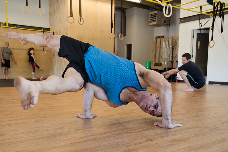 "Jon Kolaska practices the QDR position during a class at Boulder Movement Collective on Thursday. The classes are programed to have aspects of hand-balancing, mobility, gymnastic strength work and a movement focused skill aspect, with some coordination, locomotion patterns and dance foot work.<br /> More photos:  <a href=""http://www.dailycamera.com"">http://www.dailycamera.com</a><br /> (Autumn Parry/Staff Photographer)<br /> July 7, 2016"
