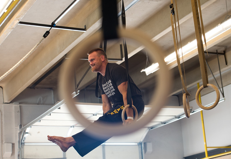 "Damon Arthur uses the gymnastic rings to do an L-sit during a class at Boulder Movement Collective on Thursday. The classes are programed to have aspects of hand-balancing, mobility, gymnastic strength work and a movement focused skill aspect, with some coordination, locomotion patterns and dance foot work.<br /> More photos:  <a href=""http://www.dailycamera.com"">http://www.dailycamera.com</a><br /> (Autumn Parry/Staff Photographer)<br /> July 7, 2016"