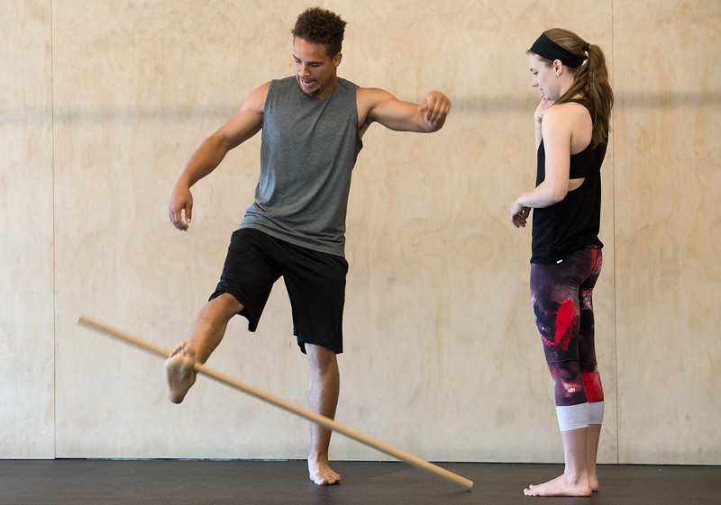 "Kain Colter and Allison Bundy practice the stick drop game during a class at Boulder Movement Collective on Thursday. The classes are programed to have aspects of hand-balancing, mobility, gymnastic strength work and a movement focused skill aspect, with some coordination, locomotion patterns and dance foot work.<br /> More photos:  <a href=""http://www.dailycamera.com"">http://www.dailycamera.com</a><br /> (Autumn Parry/Staff Photographer)<br /> July 7, 2016"