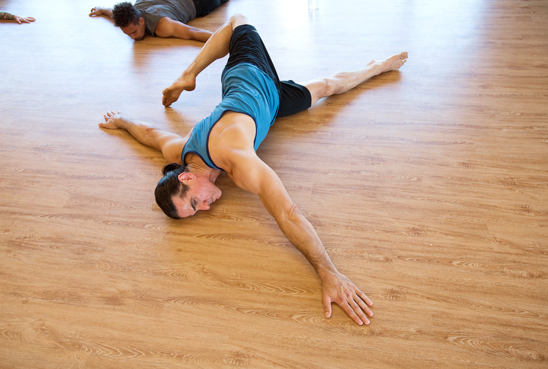 "Jon Kolaska stretches for an exercise during a class at Boulder Movement Collective on Thursday. The classes are programed to have aspects of hand-balancing, mobility, gymnastic strength work and a movement focused skill aspect, with some coordination, locomotion patterns and dance foot work.<br /> More photos:  <a href=""http://www.dailycamera.com"">http://www.dailycamera.com</a><br /> (Autumn Parry/Staff Photographer)<br /> July 7, 2016"