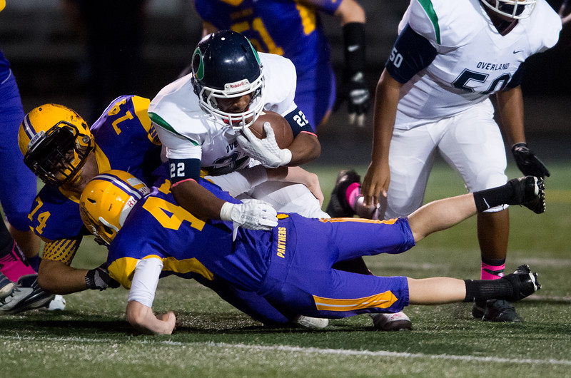 """Boulder's Joe Colucci helps tackle Overland's Jaion Colbert during the game at Boulder High School on Friday. <br /> More photos:  <a href=""""http://www.BoCoPreps.com"""">http://www.BoCoPreps.com</a><br /> (Autumn Parry/Staff Photographer)<br /> October 14, 2016"""