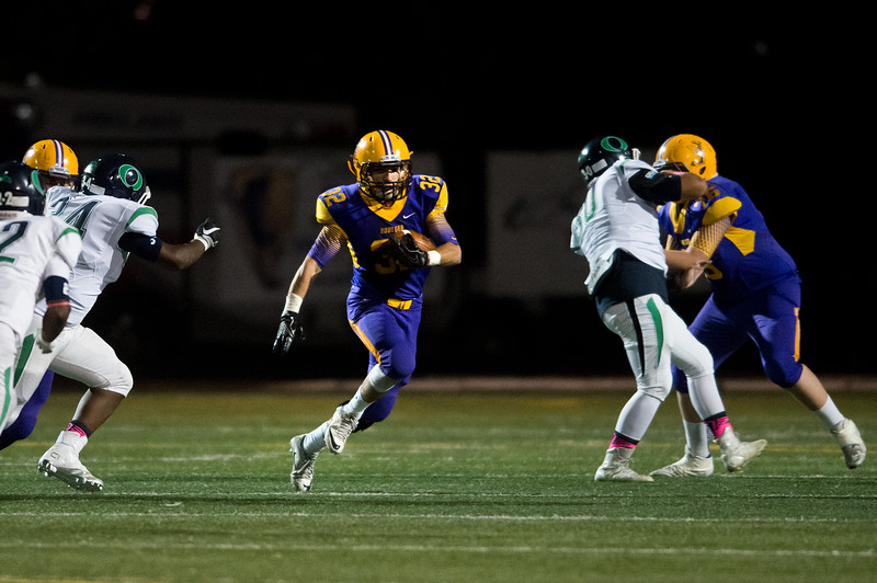 """Boulder's Patrick Fletcher runs the ball down the field during the game against Overland at Boulder High School on Friday. <br /> More photos:  <a href=""""http://www.BoCoPreps.com"""">http://www.BoCoPreps.com</a><br /> (Autumn Parry/Staff Photographer)<br /> October 14, 2016"""