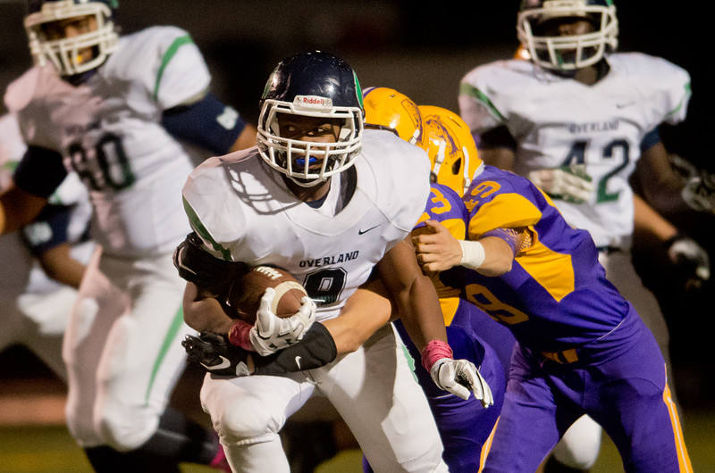 """Overland's Donovan Carver is tackled by Boulder's defense during the game at Boulder High School on Friday. <br /> More photos:  <a href=""""http://www.BoCoPreps.com"""">http://www.BoCoPreps.com</a><br /> (Autumn Parry/Staff Photographer)<br /> October 14, 2016"""