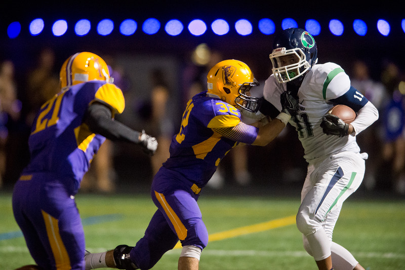 """Boulder's Patrick Fletcher tackles Overland's Jalone Rice during the game at Boulder High School on Friday. <br /> More photos:  <a href=""""http://www.BoCoPreps.com"""">http://www.BoCoPreps.com</a><br /> (Autumn Parry/Staff Photographer)<br /> October 14, 2016"""