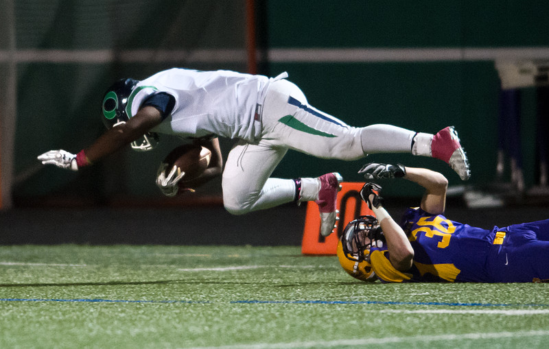 """Boulder's Wilson Maier tackles Overland's Donovan Carver during the game at Boulder High School on Friday. <br /> More photos:  <a href=""""http://www.BoCoPreps.com"""">http://www.BoCoPreps.com</a><br /> (Autumn Parry/Staff Photographer)<br /> October 14, 2016"""