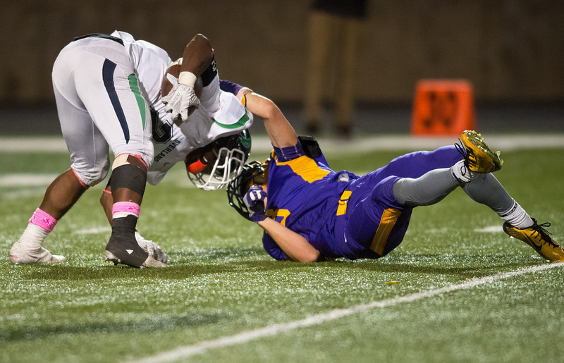 """Boulder's Ryan Travis tackles Overland's Jaion Colbert during the game at Boulder High School on Friday. <br /> More photos:  <a href=""""http://www.BoCoPreps.com"""">http://www.BoCoPreps.com</a><br /> (Autumn Parry/Staff Photographer)<br /> October 14, 2016"""