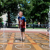 "Shay Johnson, 8, stands over the water jets as he is sprayed in the face with water at the Pearl Street Mall in Boulder on Friday. <br /> More photos:  <a href=""http://www.dailycamera.com"">http://www.dailycamera.com</a><br /> (Autumn Parry/Staff Photographer)<br /> July 22, 2016"